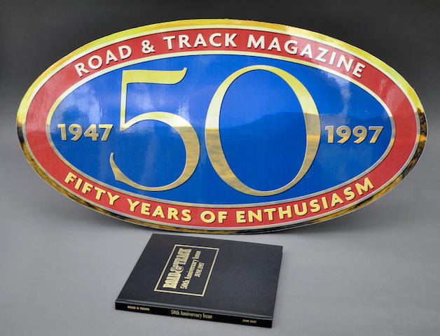 A Road & Track 50th Anniversary wall hanging with hard-bound issue