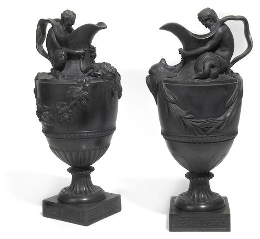 A companion pair of Wedgwood black basalt wine and water ewers: Sacred to Bacchus and Neptune  19th century