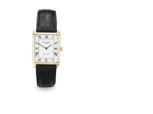 A gentleman's gold wristwatch with black crocodile strap