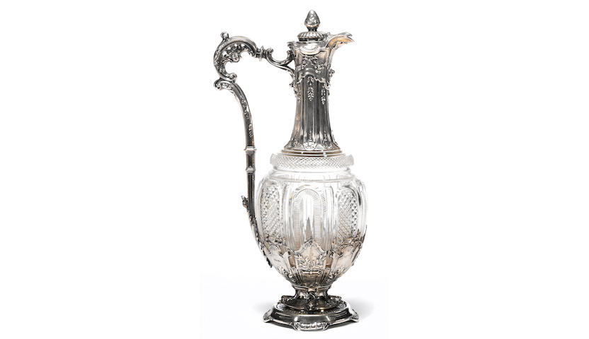 A continental silver mounted cut glass claret jug With English import marks for John Willis Dixon, London, 1900