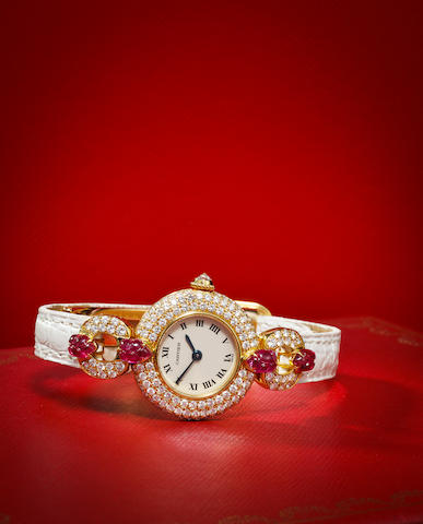 Cartier. A fine diamond and ruby-set rose gold lady's wristwatchRef: 1989, no. C88986, 1990's