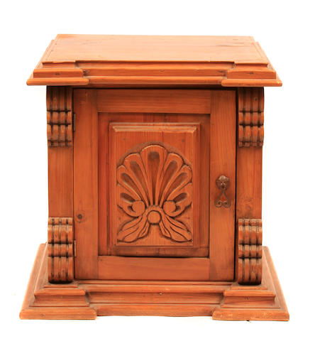 A Baroque style pine cupboard