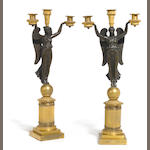 A pair of Empire style patinated and gilt bronze three light figural candelabra <br>late 19th century