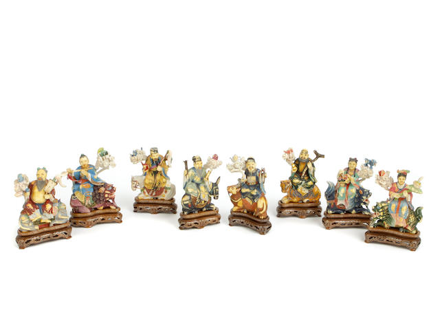 A group of eight small polychrome ivory figures of Immortals
