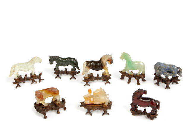 "A group of eight miniature hardstone carvings of ""The Eight Horses of Mu Wang"""