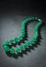 An emerald bead, onyx and diamond necklace, Cartier,