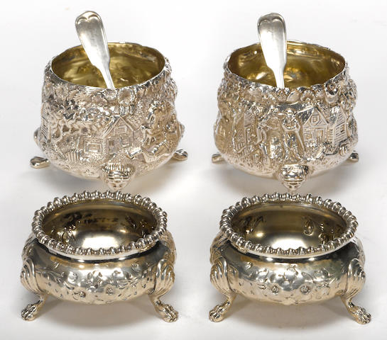 A coin and sterling group of salt cellars and spoons
