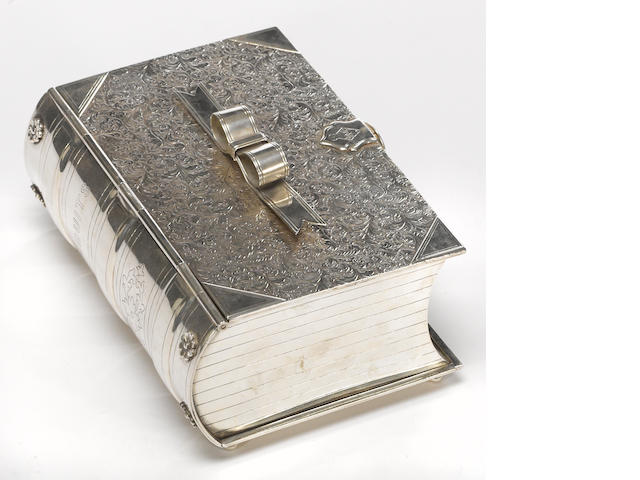 "A Victorian electroplated novelty biscuit box as a book, with registry mark Maker's marks: fleur de lis, figure in boat, D & S <br># 14, with inscription on the interior: ""Presented to Mr. Edward Trimen on his leaving Broomlands, by a few friends as a mark of esteem and respect, 1884"""