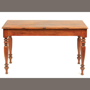 A Neoclassical style mixed wood farmhouse table