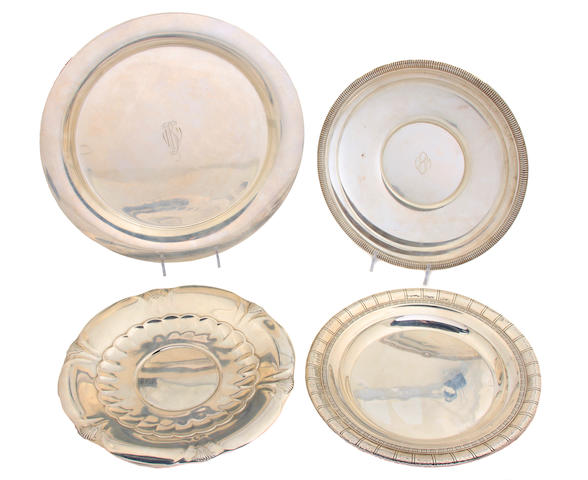 A group of four American sterling silver Modernist plates 20th century