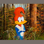 A Walter Lantz painting of Woody Woodpecker in a forest