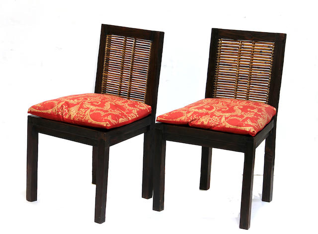 A set of eight Tucker Robbins rattan chairs with red upholstery cushion