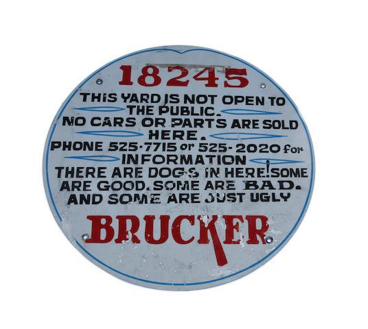 A Von Dutch Custom Painted and Pinstriped 'Brucker' Round Metal Sign,