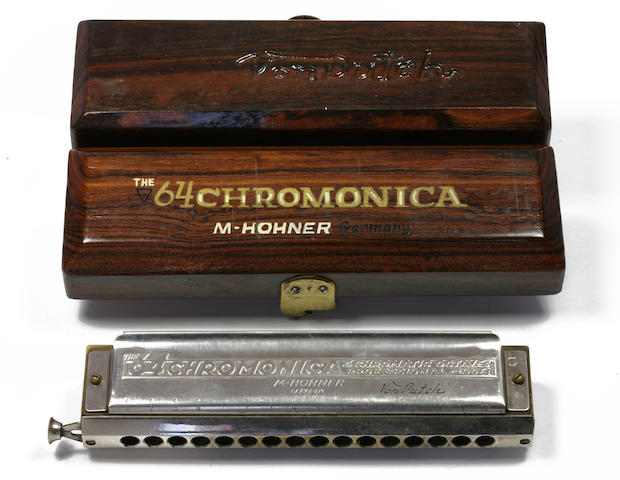A Von Dutch engraved harmonica with custom wooden box,