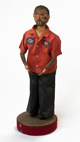A paper mache statuette of Ed Roth,