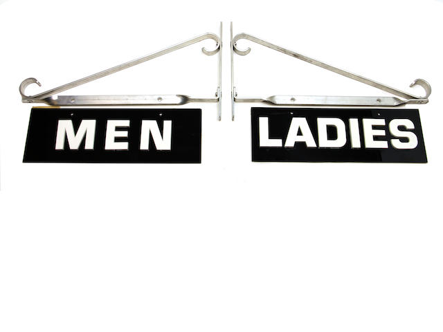 A Shell Station mens/ladies room signs,