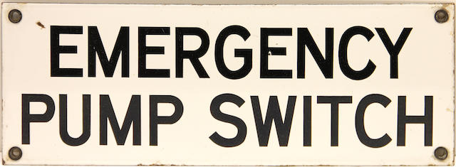 An 'Emergency Pump Switch' sign,