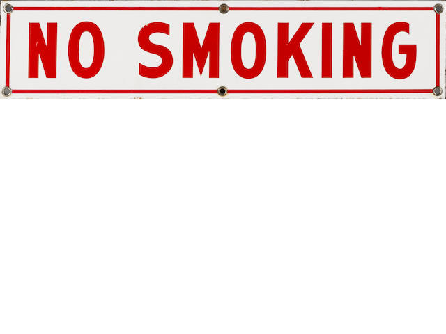 "A ""No Smoking"" sign,"