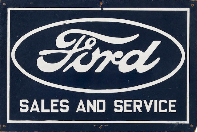 A Ford Sales and Service sign,