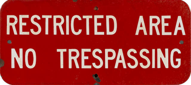 "A ""Restrictd Area No Tresspassing"" sign,"