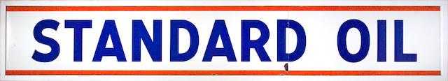 A large Standard Oil station banner sign,