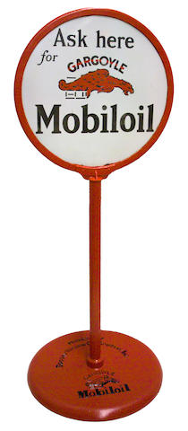 A Mobiloil curb sign with embossed base,