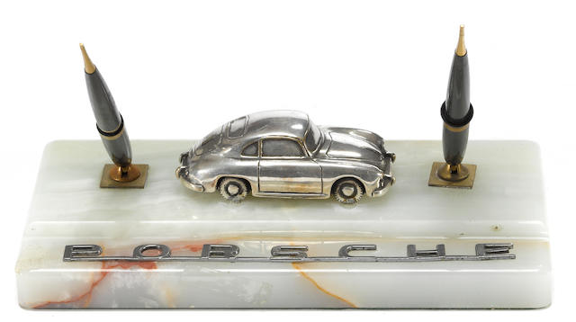 A Porsche 356 marble desk set and letter opener,