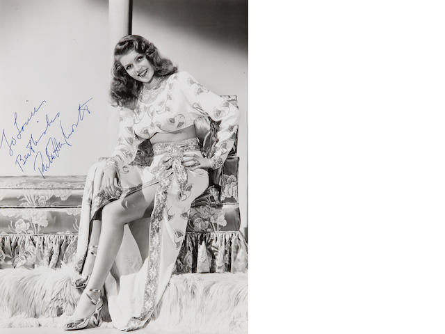 Signed photo of Rita Hayworth 8 x 10. Gilda. White Dress.