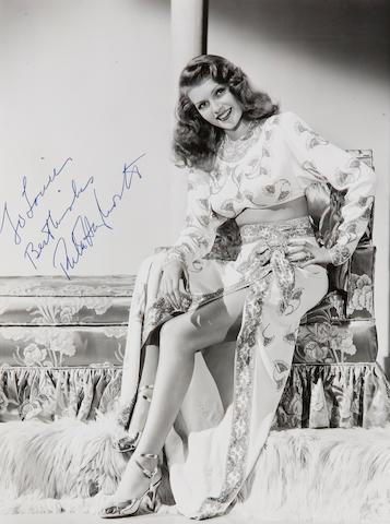 Signed photo of Rita Hayworth 8 x 10. Gilda. White Dress.