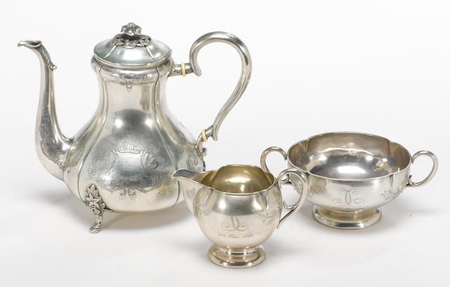A Danish silver assembled three piece coffee set with engraved decoration Michelsen, Copenhagen, 1850 and 1864  Engraved: fra Venner i Helsingor and monogrammed: TC