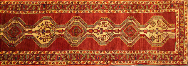A Malayer runner size approsimately 3ft. 6in. x 12ft. 4in.