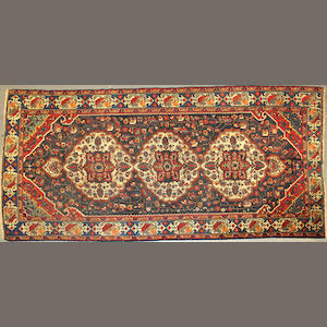A Bakhtiari long carpet size approximately 6ft. x 11ft. 1in.