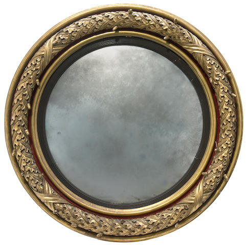 A Regency giltwood and gesso convex mirror  first quarter 19th century