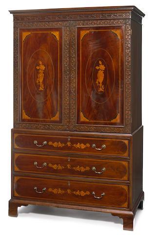 A George III inlaid mahogany linen press