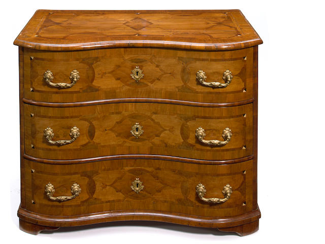 A South German Rococo marquetry inlaid walnut serpentine commode <br>mid 18th century