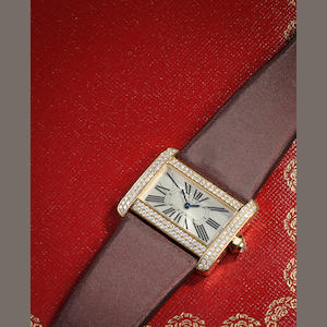 "a ladies Cartier diamond ""Divan"" wristwatch, with box, extra strap and papers"