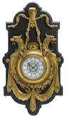 A Napoleon III gilt bronze cartel clock
