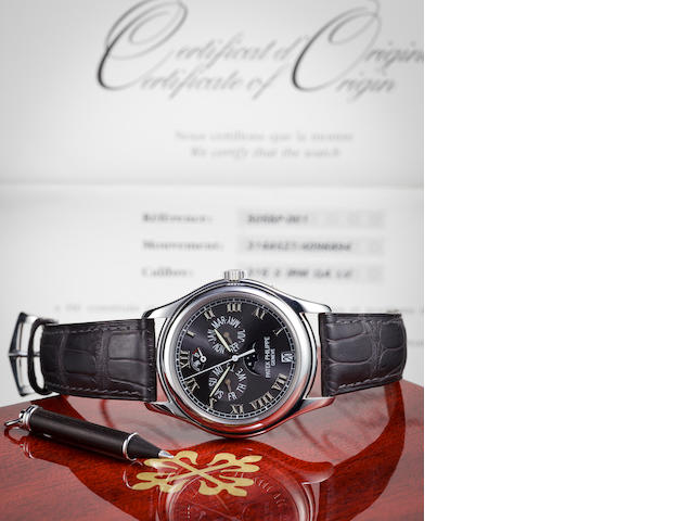 Patek Philippe. A platinum black dial wristwatch with annual calendar,  Ref. 5056.