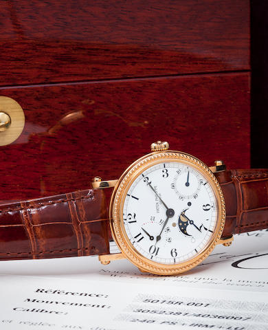 Patek Philippe. A fine 18K rose gold automatic wristwatch with power reserve and phase and age of the moonRef:5015R, Case no. 4036007, Movement no. 3052381, sold 1999