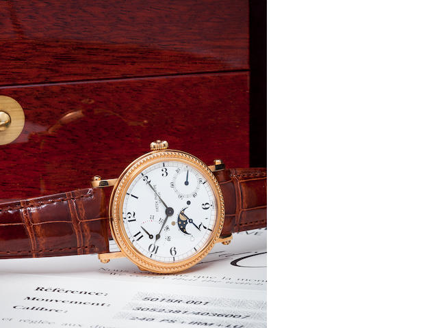 Patek Philippe. A rose gold annual calendar wristwatch with phases of the moon and power reserve indication, Ref. 5015r.