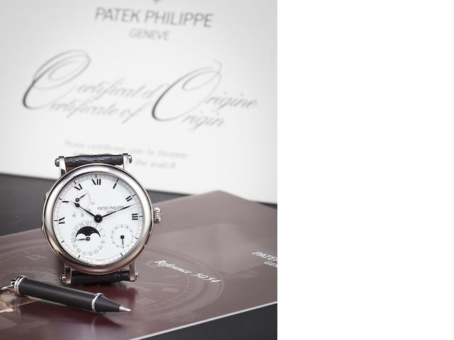 Patek Philippe. A white gold annual calendar wristwatch with phases of the moon and power reserve indication, Ref. 5054g.