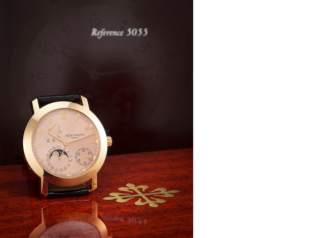 Patek Philippe. A rose gold annual calendar wristwatch with phases of the moon and power reserve indication, Ref. 5055r.