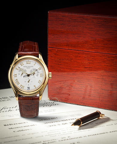 Patek Philippe. A fine 18K gold automatic center seconds wrist watch with annual calendar Ref:5035J, Case no. 4042321, Movement no. 3059293, sold 1999