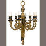 A Louis XVI style gilt and patinated bronze eight light chandelier