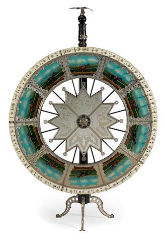 An eglomise fortune wheel  Mason & Co., Newark NJ