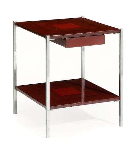 A chrome and lacquered two tier occasional table