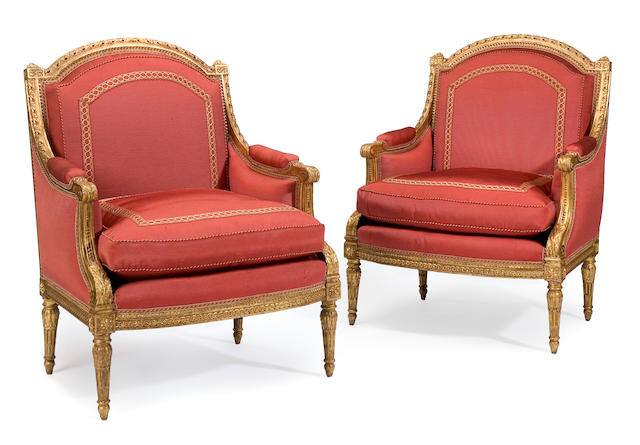A pair of Louis XVI sytle carved giltwood bergeres <br>late 19th century