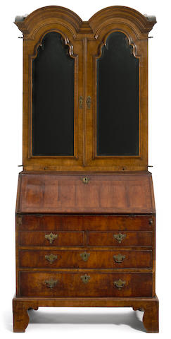 A Queen Anne featherbanded walnut double domed top secretary bookcase <br>first quarter 18th century