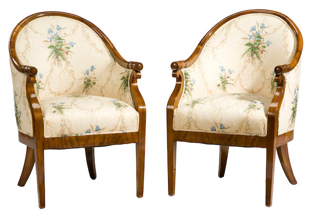 A pair of Late Empire walnut tub armchairs