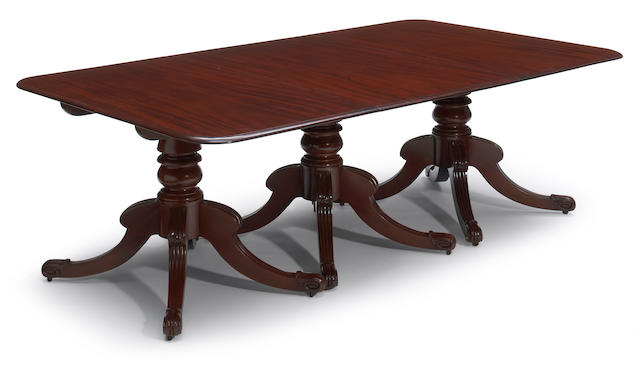A Regency style mahogany triple pedestal dining table